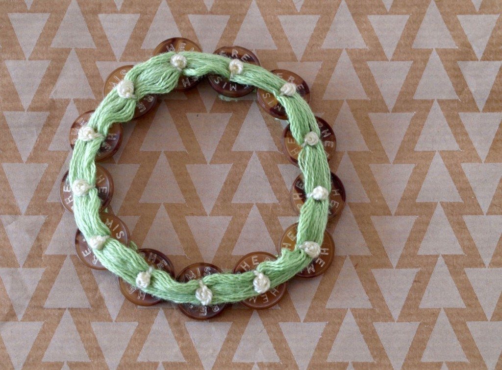Bracelet from green thread and brown buttons with French Knots